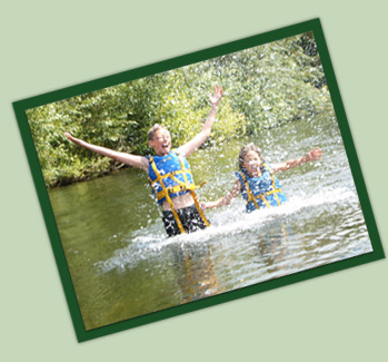 Youth Splashing in the River Wye - Forest Adventure